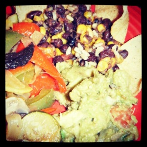 Heather's black bean and corn mix on rice, with homemade guacamole and fajita vegetables. Served with chips, salsas, and fat-free cheese.