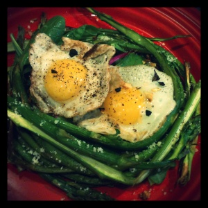 When the yolks are broken and mix with the parmesan, roasted garlic, and cracked black pepper, you have a creamy dressing for your baby greens and asparagus.