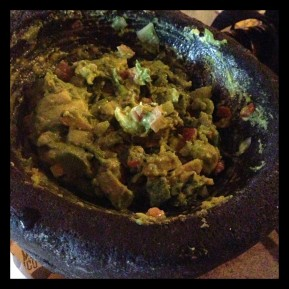 Mortar-crushed avocado, tomato, onion, and cilantro make for a great appetizer to share.