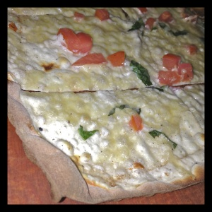 """A vegetarian """"flammy,""""  the Provencale, topped with creme fraiche, basil, and tomato - the inspiration behind my Cauliflower Crust Pizzette."""