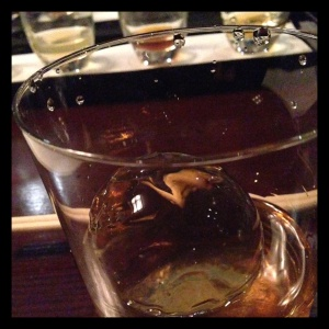 The round, molded ice cube has a slow melting rate, allowing the whisky to remain cool without too much bloom.