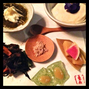 Clockwise from Top Left: Mozuku with fresh grated ginger; Housemade tofu with edible pansy; bamboo root with white miso vinegar; Vegan sashimi with white miso vinegar; Hijiki seaweed salad.