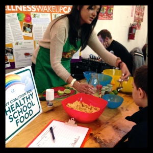 This year, the annual raffle benefitted the NY Coalition for Healthy School Food. Here, a little boy learns to make a healthy snack for lunch.