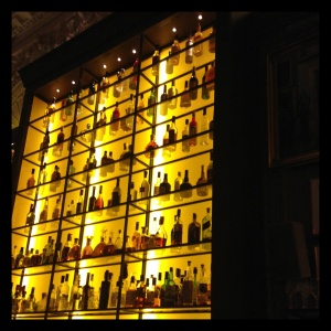 The iconic backlit bar at the new London EDITION hotel is as buzzy as the bartenders' signature sips.